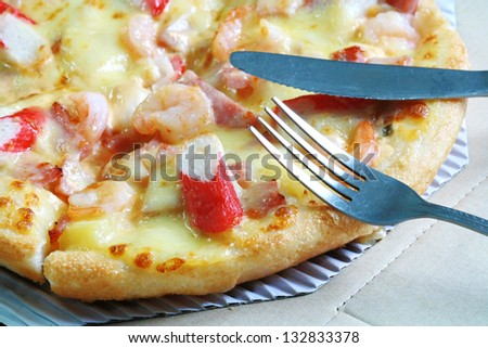 pizza with fork and knife - stock photo