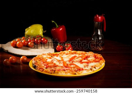 Pizza with pepper slices and cheese - stock photo