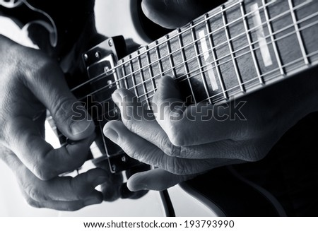 playing notes on a blues guitar - stock photo