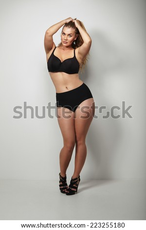 . Plus size caucasian female model in underwear with beautiful curves. - stock photo