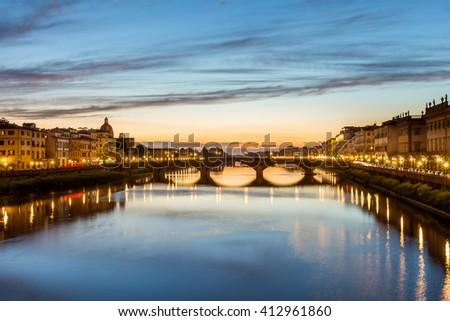 Ponte Santa Trinita (Holy Trinity Bridge) over River Arno, View of after sunset gone at Ponte Santa Trinita- Florence, Tuscany, Italy. - stock photo
