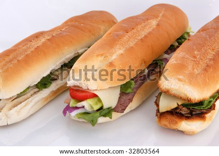 3 popular sandwiches - Chicken Caesar, Deli giant and Philly on white