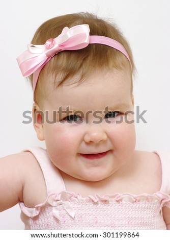 Portrait of a baby girl smiling