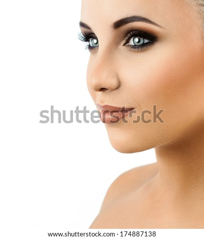 portrait of a beautiful girl on a light background. makeup - stock photo