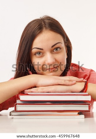 Portrait of a beautiful student with books  - stock photo