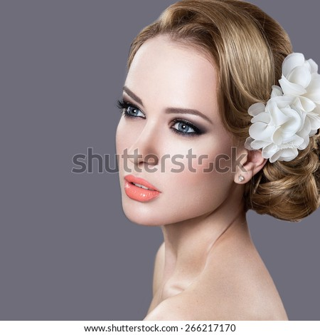 Portrait of a beautiful woman in the image of the bride. Picture taken in the studio on a grey background. Beauty face - stock photo