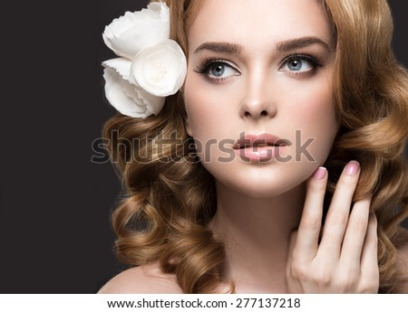 Portrait of a beautiful woman in the image of the bride with flowers in her hair. Picture taken in the studio on a black background. Beauty face - stock photo