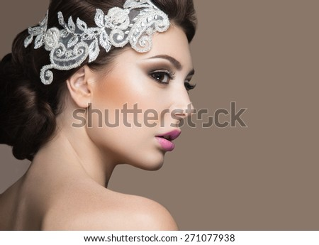 Portrait of a beautiful woman in the image of the bride with lace in her hair. Picture taken in the studio. Beauty face