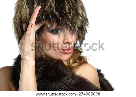 portrait of a beautiful young woman in furs. beautiful makeup,  bright emotions