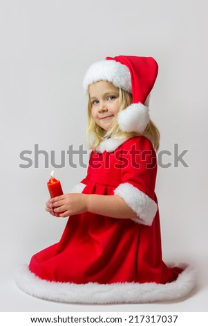 Portrait of a girl with christmas candle