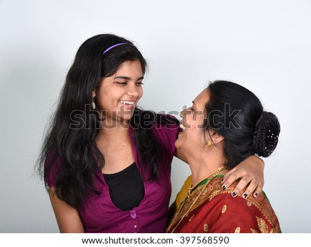 Portrait of a happy woman with her daughter - stock photo