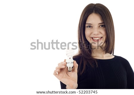 Portrait of a happy young saleswoman holding an energy efficiency light bulb isolated on white, a lot of copyspace. - stock photo