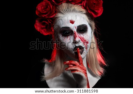 Portrait of a horrible scary zombie woman. Halloween. - stock photo