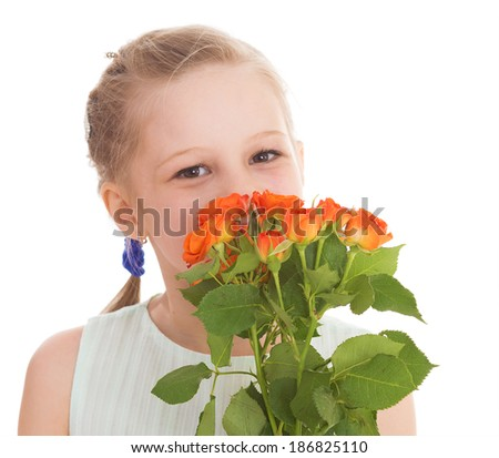 Portrait of a little girl, she is holding a bouquet of pink roses on a holiday.Isolated on white background. - stock photo