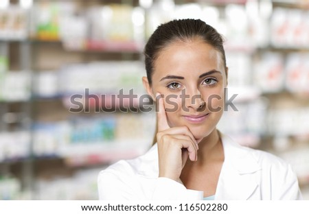 Portrait of a medical personnel, or doctor in pharmacy - stock photo