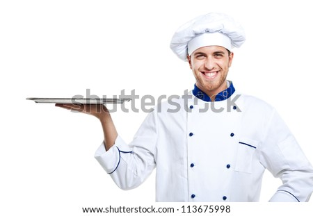 Portrait of a professional chef holding an empty dish. Isolated on white - stock photo
