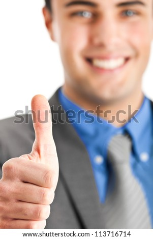 Portrait of a successful businessman with thumbs up - stock photo