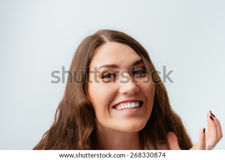 portrait of a young girl laughing - stock photo