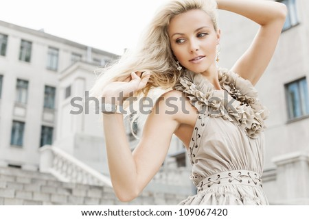 Portrait of a young girl. Outdoors - stock photo