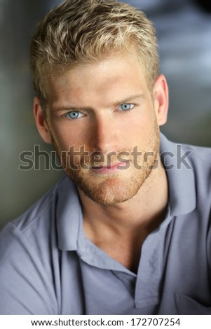 Portrait of a young handsome caucasian man smiling