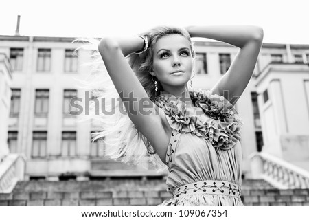 Portrait of a young pretty woman walking on the streets of old european city. Outdoors - stock photo