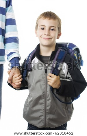 Portrait of an adorable young boy going to school with his father against white background - stock photo