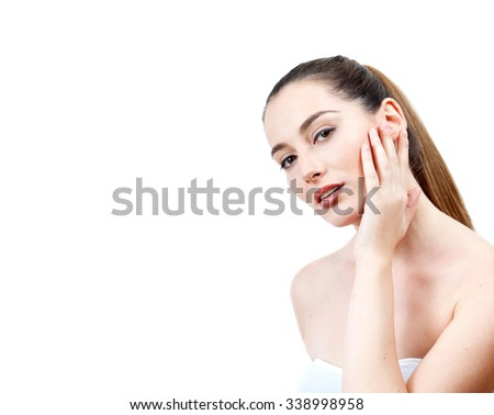 Portrait of Beautiful Young Woman Naked with Long Brown Hair on the White Background. Waist Up. Advertising Space - stock photo
