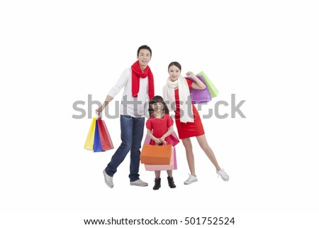 Portrait of daughter holding shopping bags,mother holding shopping bags over shoulder,father holding bags