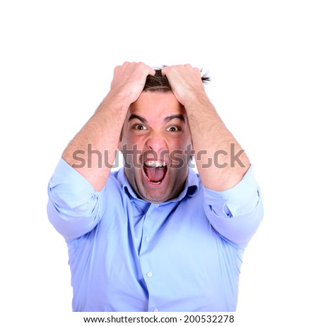 Portrait of extreme angry businessman pulling hair and screaming isolated on white - stock photo