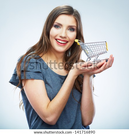 Portrait of happy smiling woman hold shopping cart. Female model isolated studio background.