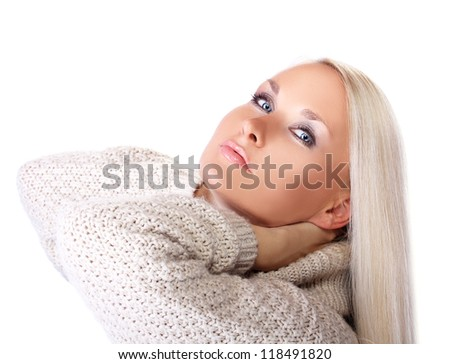 Portrait of luxury blonde looking at camera - stock photo