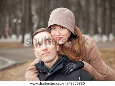 Portrait of nice man and woman in cool autumn day.