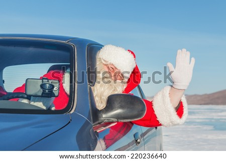 Portrait of Santa Claus in the car, shooting was conducted in a sunny day on lake Baikal - stock photo