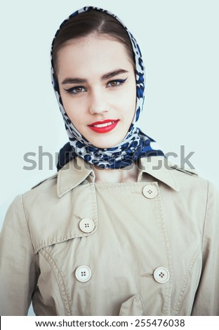 portrait of sexy smiling caucasian young woman model with glamour red lips,bright makeup, eye arrow makeup, purity complexion. Perfect clean skin.white teeth,leopard scarf - stock photo
