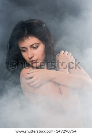 Portrait of the young girl in a smoke - stock photo