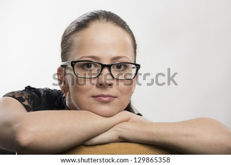 Portrait of the young woman in glasses - stock photo