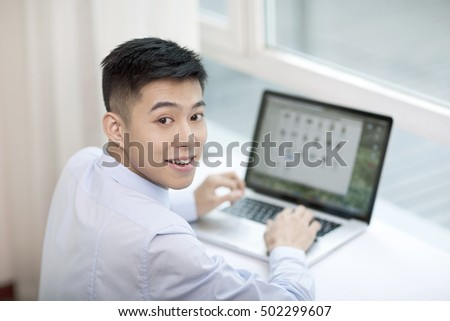 Portrait of young bisinessman with laptop