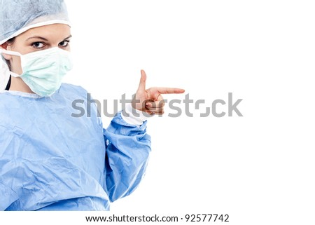 portrait of young female surgeon in scrubs, with isolated background