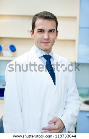 portrait of young handsome success doctor - stock photo