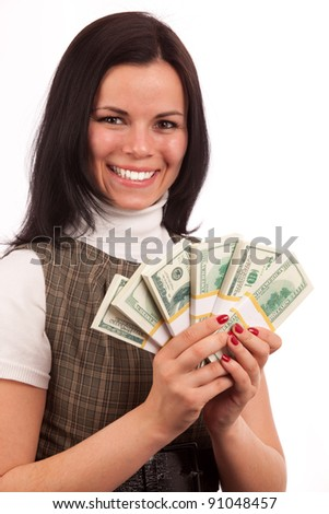 portreit of beautiful woman with bundles of American dollars on white background