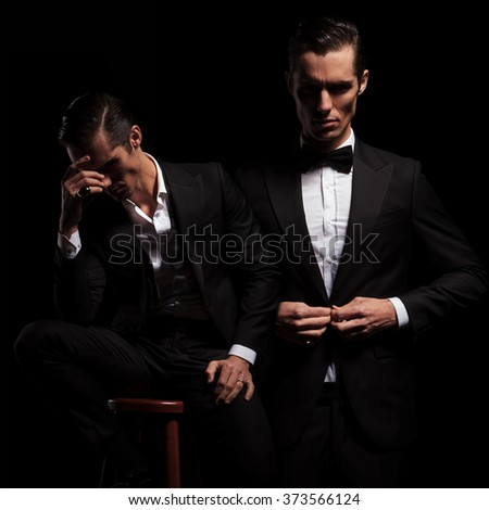 2 poses of elegant businessman in black suit with bowtie. one seated thoughtful insecure and one confident closing his jacket.  - stock photo