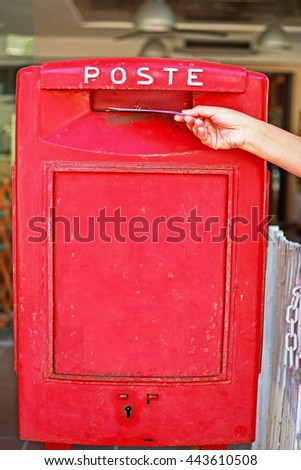 POST word in Italian on vintage red metal post box, Milano Marittima, Italy