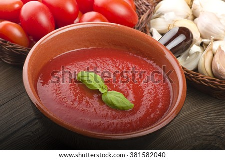 pot with tomato sauce and basil leaves  - stock photo
