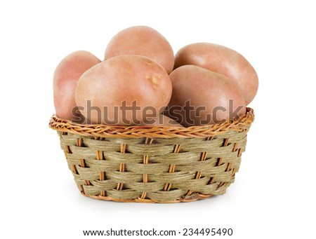 potatoes in basket isolated on white - stock photo