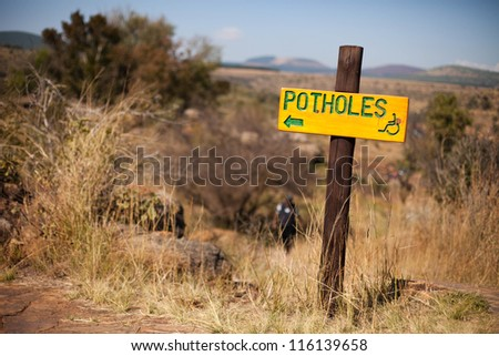 'Potholes' sign at Bourke's Luck Potholes, Mpumalenga, South Africa - stock photo