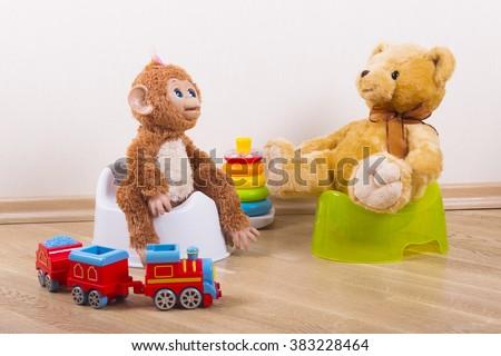 potty training teddy toy monkey - stock photo