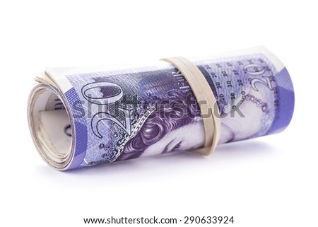 20 pounds banknotes rolled up and tightened with rubber band isolated on white background - stock photo