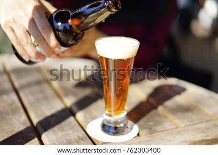 https://thumb1.shutterstock.com/display_pic_with_logo/167494286/762303400/stock-photo--pour-a-beer-762303400.jpg