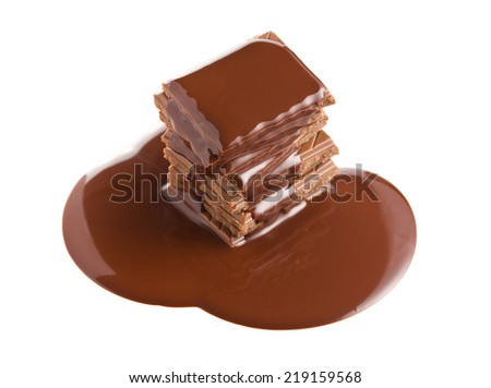 pouring chocolate on the chocolate bar - stock photo