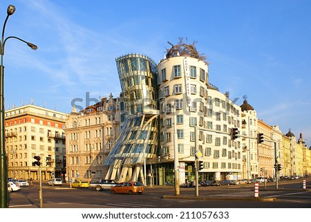 PRAGUE,CZECH REPUBLIC - JULY 18, 2014. Street view with famous  Dancing House ,its nickname is Fred and Ginger House after the famous dancers. Street traffic in Prague.
